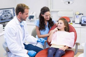 Dentist and Nurse working with Child